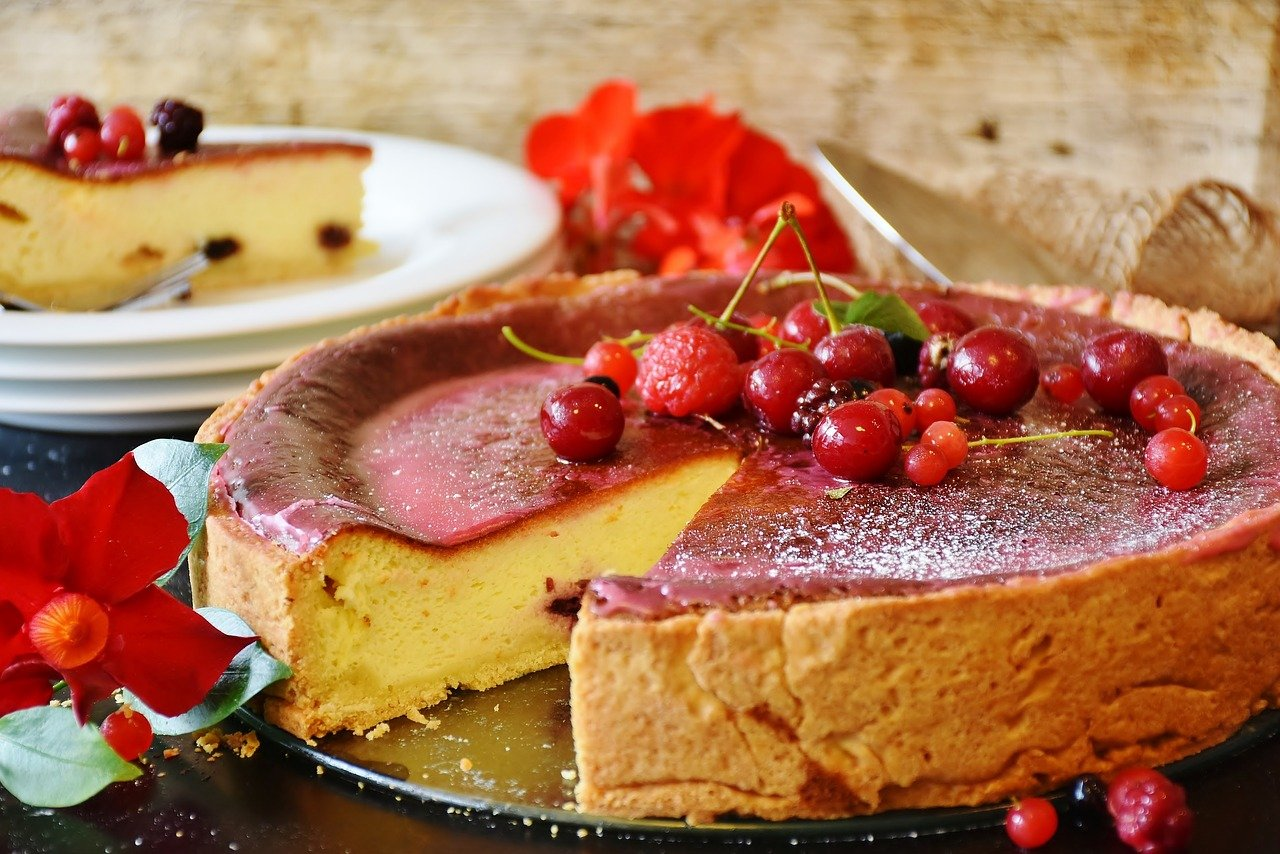 A cheesecake with fruit compote representing a mishti doi cheesecake for Durga puja
